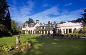 A great big pink country house in the midst of the Trossachs National Park.